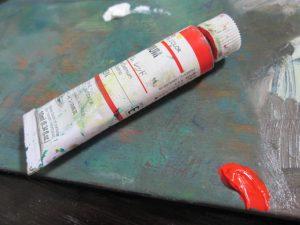 油絵の赤の絵の具がある画像