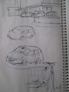 スケッチブックに車が描いてある画像