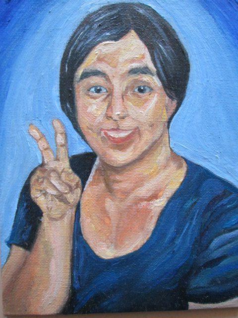 女性の肖像画を描いた油絵