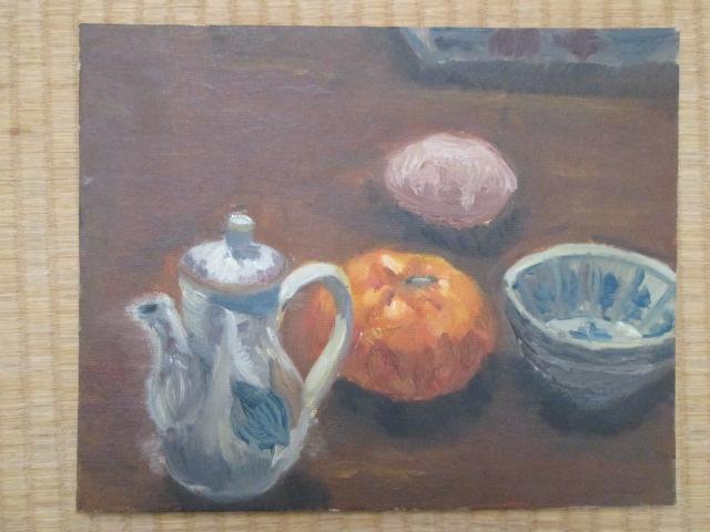 ミカンや小皿などのある油絵