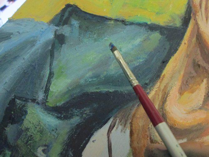 油絵を描いている画像