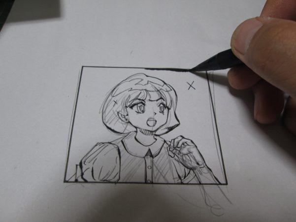 コマ枠にそって筆ペンでベタ塗りをしている画像
