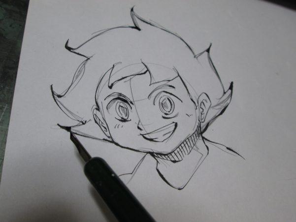 少年のイラストを描いている画像