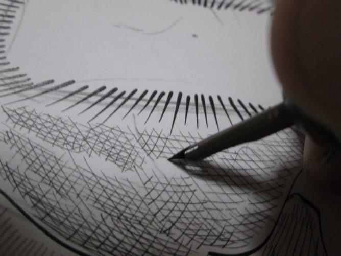 ペン入れをしている画像