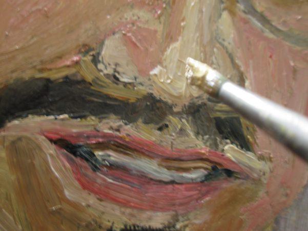 人の顔を油彩で描いてる画像